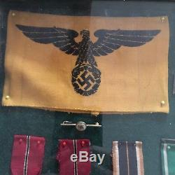 Framed Set Of Original WWII German Medals And Badges
