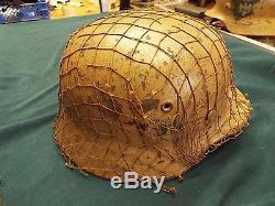 Original Ww2 German M40 Dak Afrika Korps Helmet With Original Camo Net