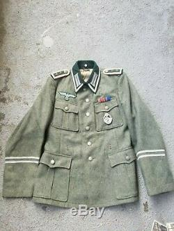 Original German WW2 tunic, trousers, boots, belt and buckle grouping lot WWII