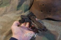 Original german ww2 battle damaged helmet and other battle remain for display