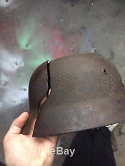 Original ww2 german elite M35 helmet, battle damaged