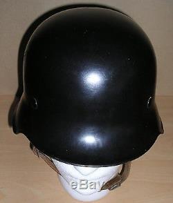Unissued WW-II German Feuerwehr M. 34 steel helmet with original neck protector