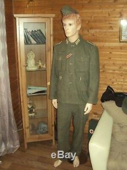 WW2 German M40 uniform kit. Cap, jacket, tunic, trousers with suspenders. Origin
