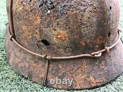 WW2 German combat helmet M40 with an original metal camouflage mesh. Size 65